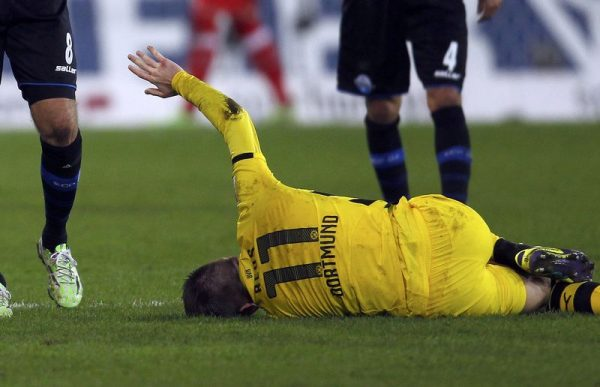 Borussia Dortmund's Reus reacts after an injury during the Bundesliga first division soccer match against Paderborn in Paderborn