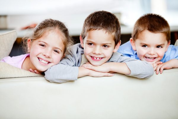 Happy group of children smiling at home