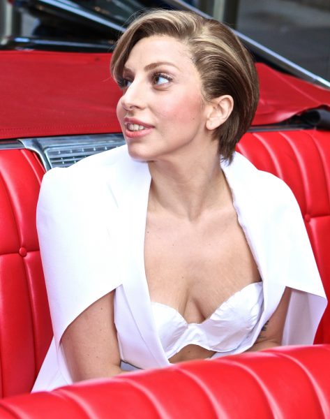 Lady Gaga shows off her cleavage in white dress at 'Good Morning America'