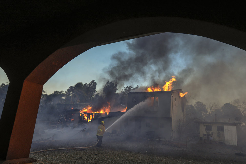 SHADOW HILLS, CA - DECEMBER 05:  A structure burns on McBroom Street on December 5, 2017 in Shadow Hills, California. (Photo by Irfan Khan/Los Angeles Times via Getty Images)