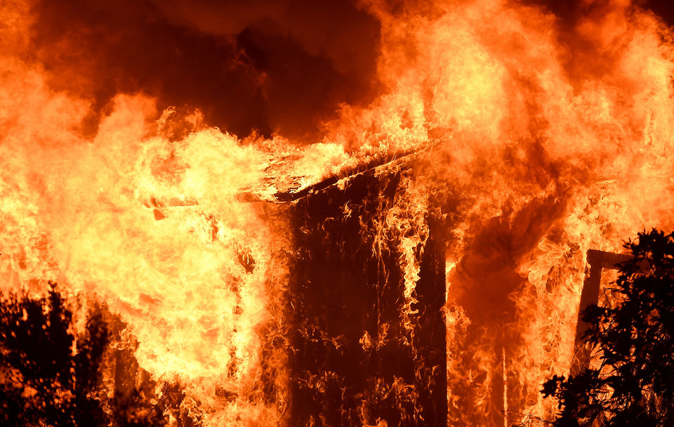 VENTURA, CA -  DECEMBER 5: A house burns along from the Thomas Fire along Highway 33 in Casita Springs in Ventura County Tuesday. (Photo by Wally Skalij/Los Angeles Times via Getty Images)
