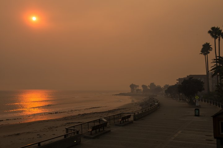 CALIFORNIA, USA - DECEMBER 6: The beach next to Ventura Pier is surrounded with smoke from the Thomas fire in Ventura, California, United States on December 6, 2017. Multiple fires around southern California have consumed thousands of acres. (Photo by Justin L. Stewart/Anadolu Agency/Getty Images)
