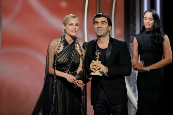 """Fatih Akin, director/producer, """"In the Fade"""" accepts the award for Best Motion Picture Foreign Language with actress Diane Kruger at the 75th Golden Globe Awards in Beverly Hills"""